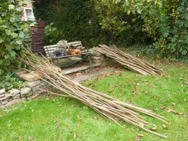 Coppicing              produce. Hedging stakes and binders. Behind the seat is a              section of hurdle also from coppice.